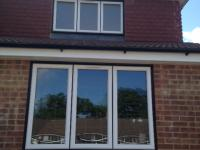 PVCu windows black frames white casements in Fleet